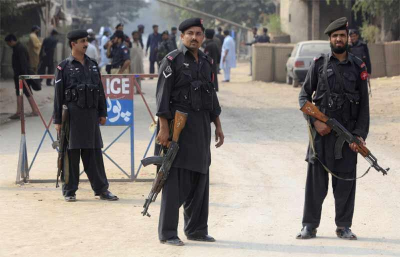 Police in Peshawar after a grenade attack wounded an passer-by and a police officer on Thursday