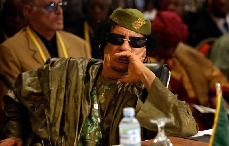 Mouammar Kadhafi, lors du sommet de l'Union africaine, près de Kampala, en juillet 2010.