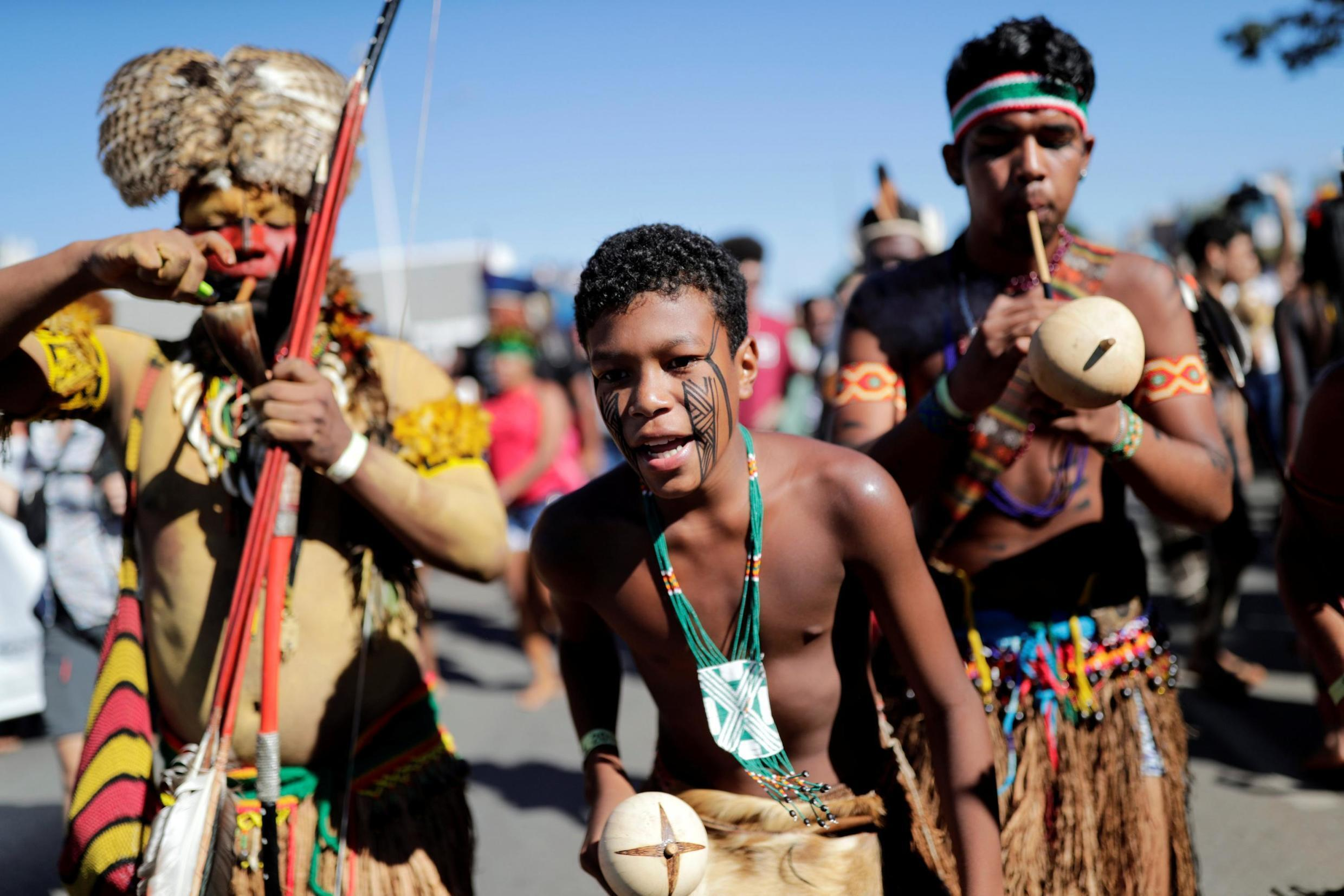 Native Brazilians take part in a protest to defend indigenous land and cultural rights that they say are threatened by the right-wing government.