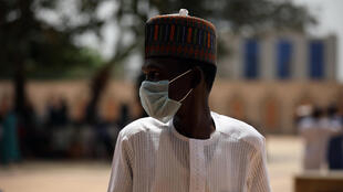 A man wears a face mask amid concerns of the spreading of the coronavirus during Friday prayers in Abuja, Nigeria on 20 March 2020.