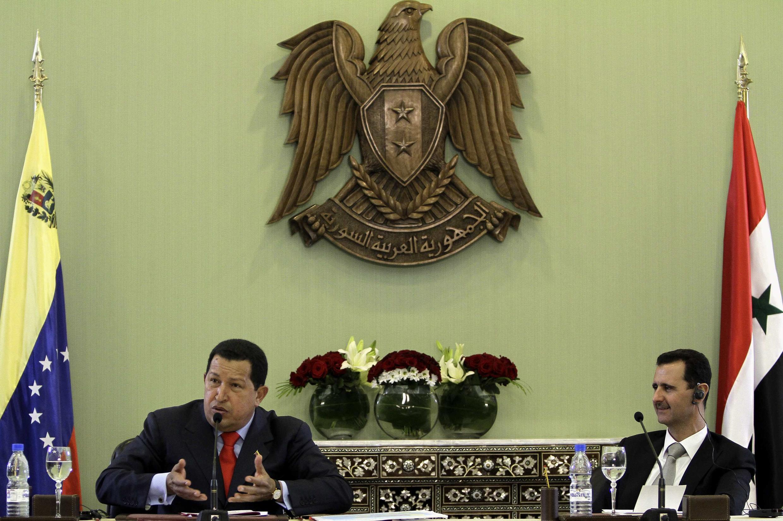 El presidente Hugo Chávez con su homólogo sirio, Bachar Al Asad.