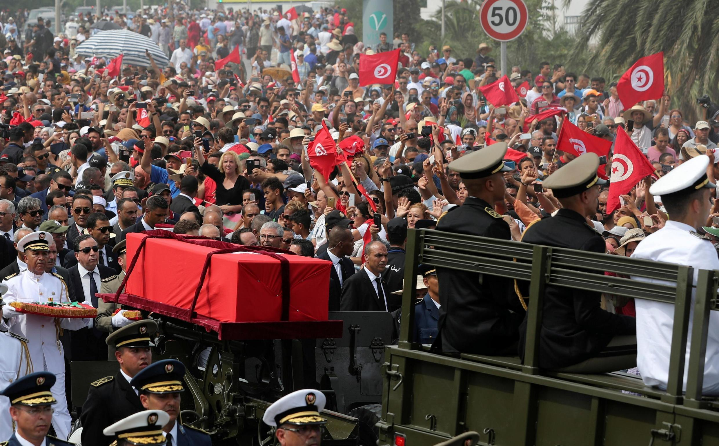 Military officers escort the coffin of late Tunisian President Beji Caid Essebsi during his funeral in Tunis, Tunisia July 27, 2019.