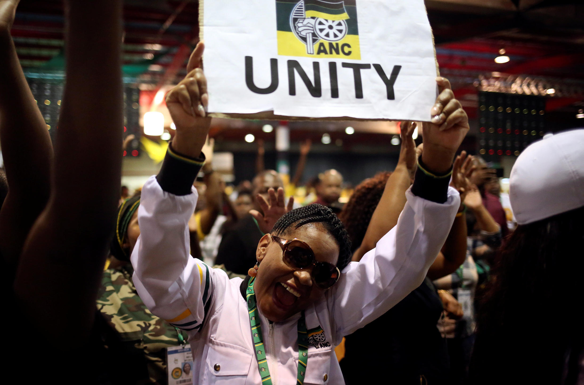 ANC members celebrate after South African Deputy president Cyril Ramaphosa was elected president of the ANC during the 54th National Conference of the ruling African National Congress (ANC), December 18, 2017