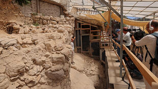 Israeli archaeologists unveil a section of wall that they have unearthed and which they say helps confirm the existence of a wall that once protected the entire eastern flank of ancient Jerusalem