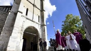 Rouen Archbishop Dominique Lebrun leads a procession to honour murdered priest Jacques Hamel at Saint-Etienne-du-Rouvray in October
