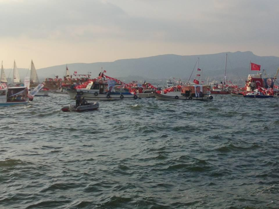 Boats decked out in party banners and flags on the Aegean