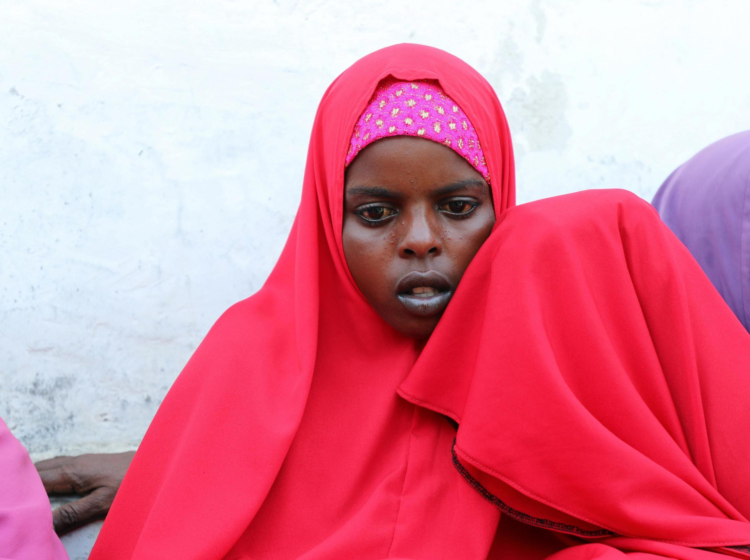 Qali Ibrahim who lost her husband in the car bomb explosion is consoled by an unknown relative during a Reuters interview at the Madina hospital in Mogadishu, Somalia December 28, 2019