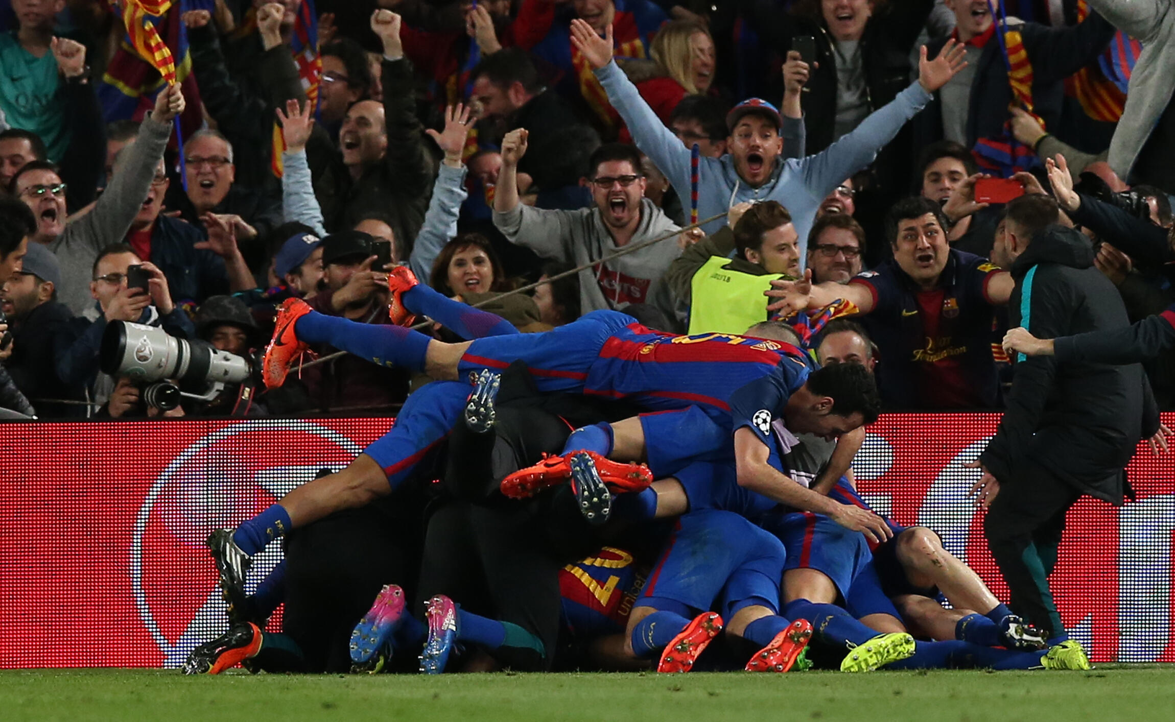 Barcelona's Sergi Roberto celebrates scoring their sixth goal with team mates in the Nou Camp, Barcelona, Spain, in March