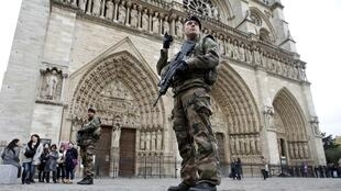 Police patrol in front of Paris's Notre Dame cathedral