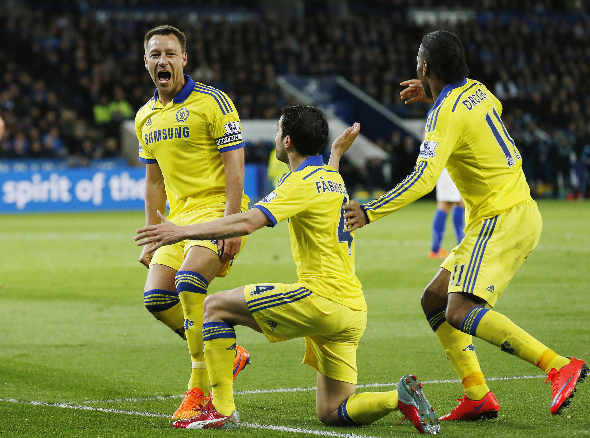 John Terry celebrates with team mates after scoring the second goal for Chelsea