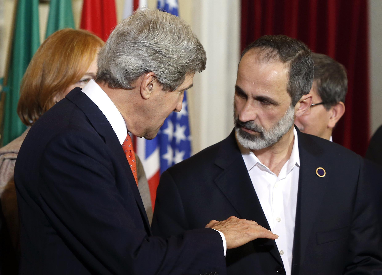 Syrian National Coalition leader Ahmed Moaz al-Khatib with US Vice-President John Kerry