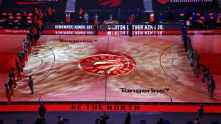The Toronto Raptors, shown before taking the court in their temprary home at Tampa, said Thursday they will finish the 2020-21 NBA campaign in the Florida arena due to Covid-19 issues involving US-Canada travel