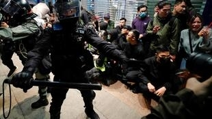 Hong Kong police confront demonstators in violent clashes during New Year's Day rally, 1 January 2020.