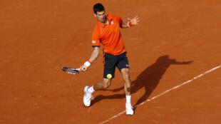 Novak Djokovic beats Richard Gasquet in three sets to face Rafael Nadal in quarter finals, Wednesday 3 June, 2015
