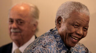 George Bizos (L), the lifelong friend and lawyer of former South African president Nelson Mandela (R) died on Wednesday at 92.