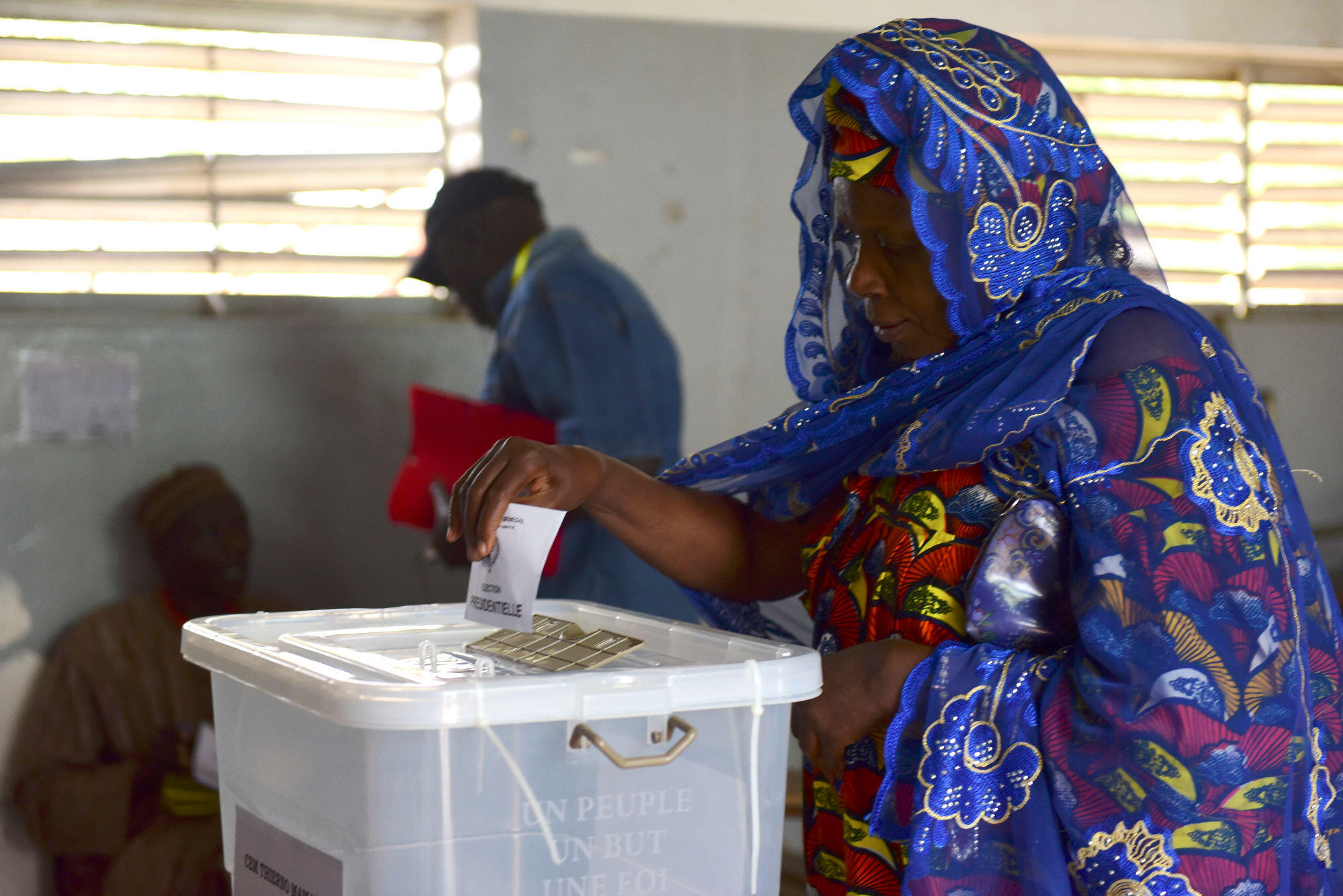 A woman casts her ballot in Senegal's presidential elections at a polling station in Fatick on 24 February 2019.