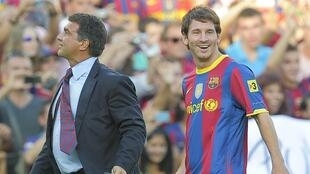 Lionel Messi tare da tsohon shugaban Barcelona Joan Laporta, da a yanzu ke neman sake darewa kujerar shugabancin kungiyar.