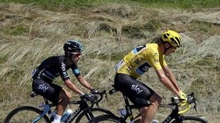 Yellow jersey leader Team Sky rider Chris Froome of Britain (R) rides with team mate Sergio Henao Montoya of Colombia during the stage.