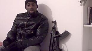 Amedy Coulibaly poses with one of the weapons