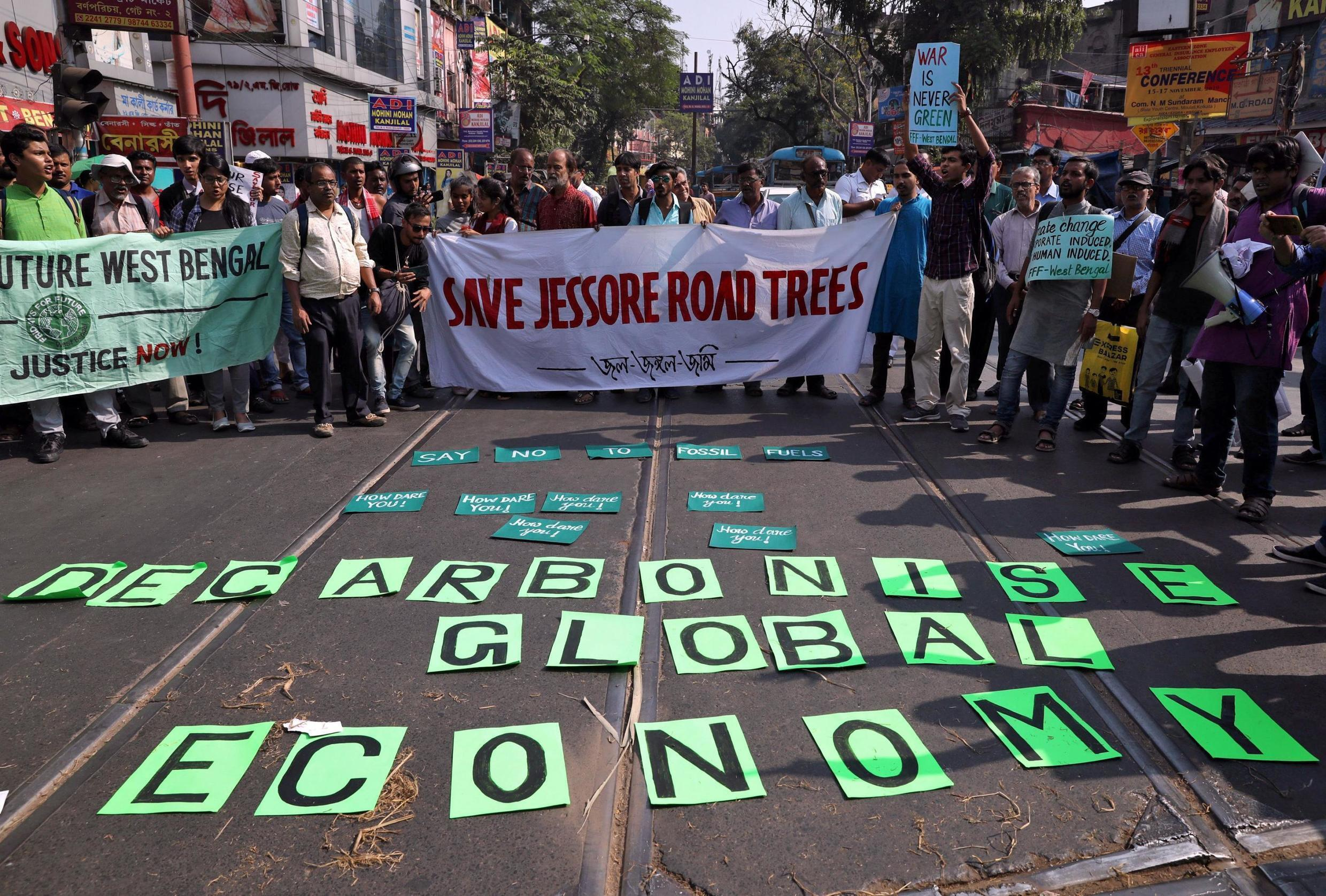 """Students take part in a """"Fridays for Future"""" march calling for urgent measures to combat climate change in Kolkata, India, 29 November, 2019."""