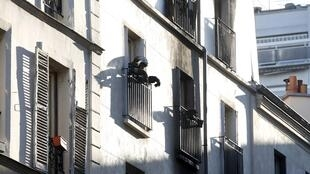 A Paris firefighter at the scene of the fire in the 18th arrondissement