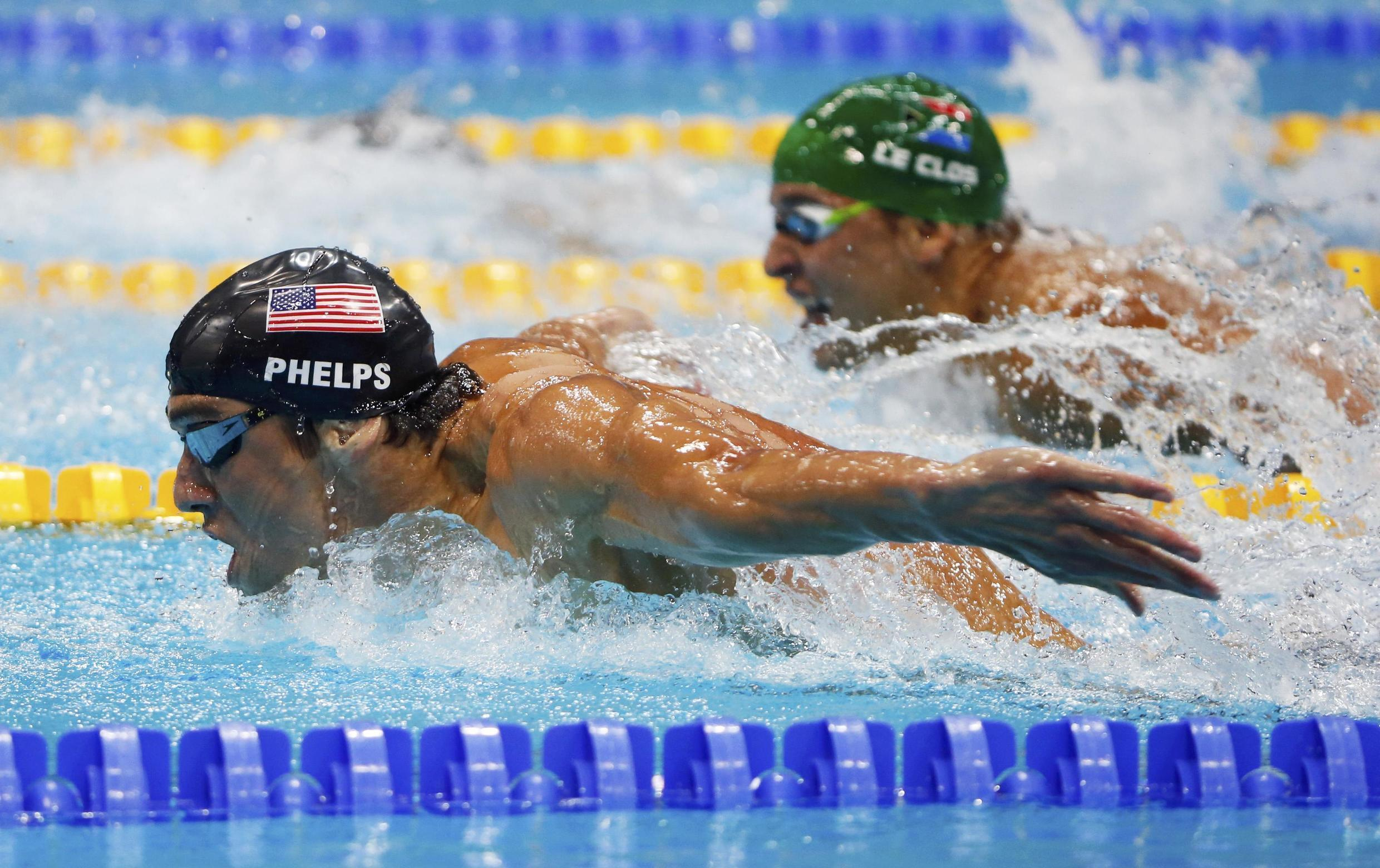 Michael Phelps swims with Chad le Clos during their men's 200m butterfly final, 31 July, 2012