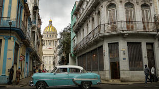 An old American car passes near the Capitol in Havana, on May 3, 2021