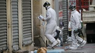 Forensic experts at the scene of the showdown in Saint-Denis, near Paris