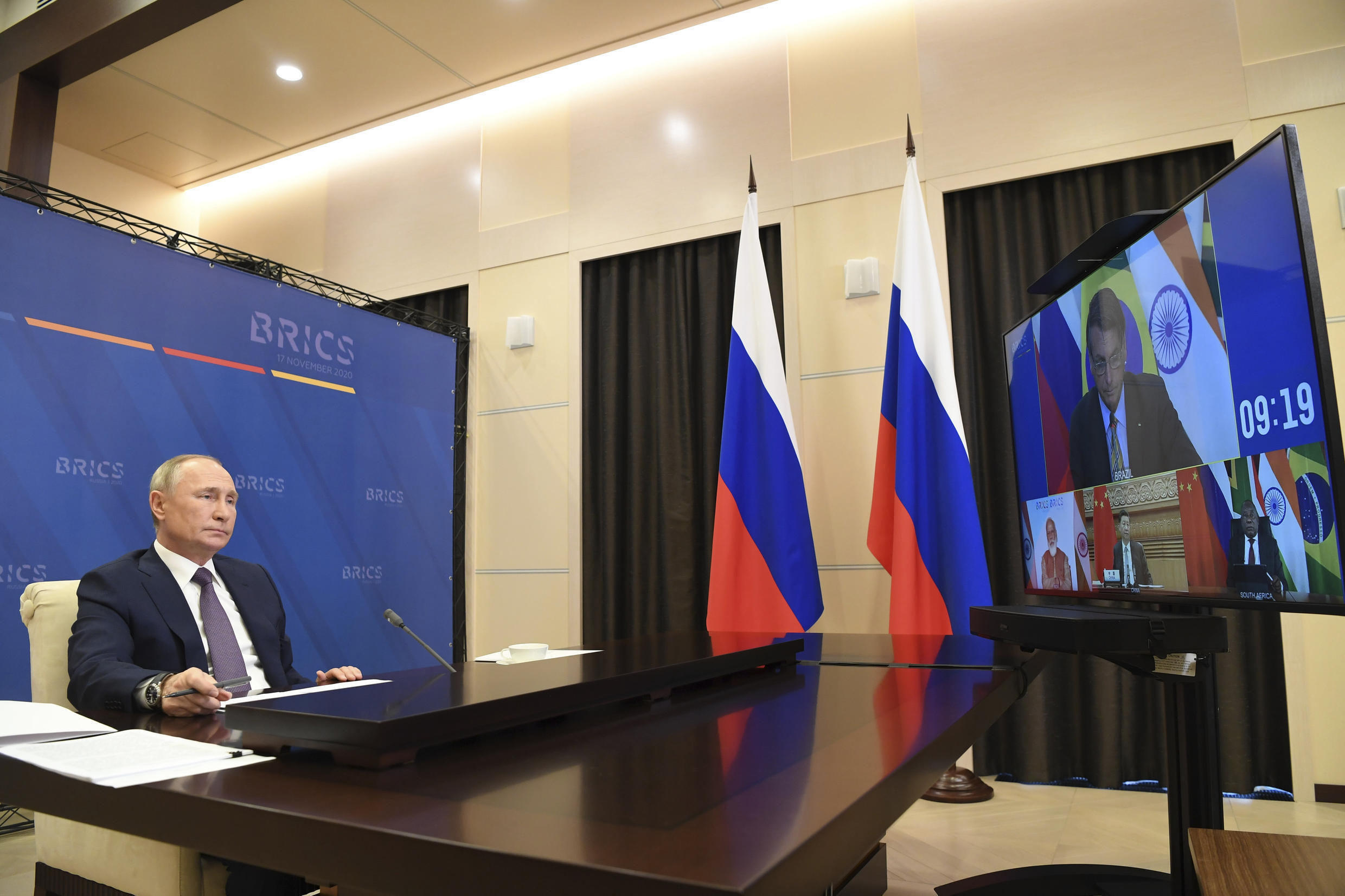 "Russian President Vladimir Putin attends a meeting with BRICS leaders via video conference at the Novo-Ogaryovo residence outside Moscow, Russia, Tuesday, Nov. 17, 2020. Russian president told BRICS leaders Tuesday that coronavirus vaccines developed in Russia ""work effectively and safely"" and urged the group of emerging economy nations to ""join forces"" in their mass production."