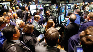 Traders of Goldman Sachs shares at the NY stock exchange. Goldman shares dropped Friday after the charges were announced