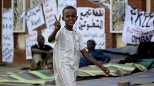 A Sudanese boy flashes the v for victory sign in Khartoum on June 2, 2019.