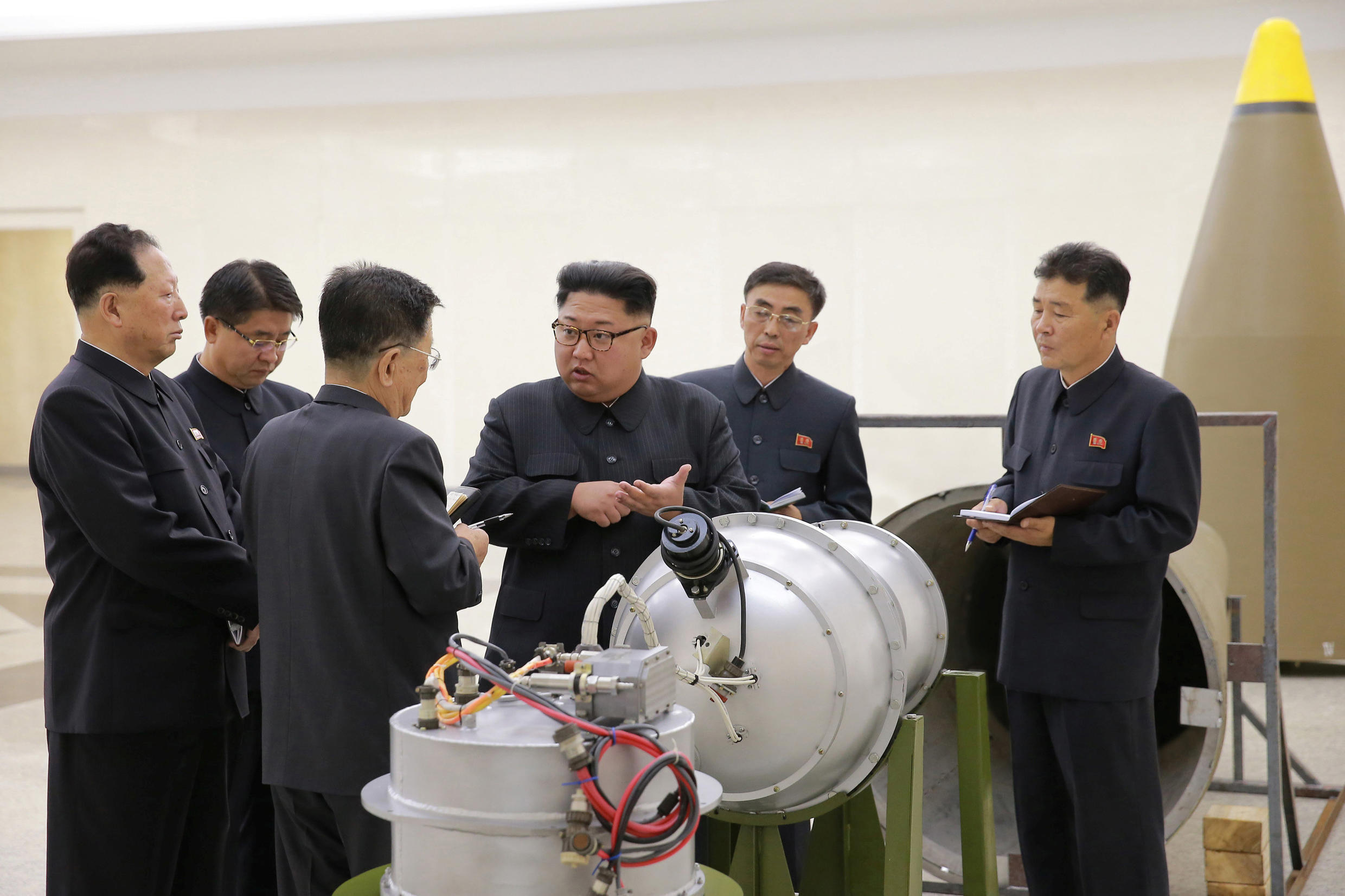 North Korean leader Kim Jong-un reportedly poses with a nuclear weapon, photo distributed by official KCNA agency