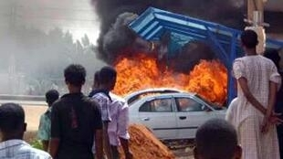 Burning cars during protests over fuel subsidy cuts in Khartoum
