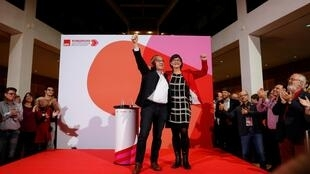 Saskia Esken and Norbert Walter-Borjans gesture after being announced as the new leaders of the Social Democratic Party in Berlin, Germany, 30 November 2019.