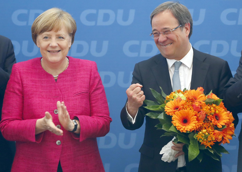 آرمین لاشت (سمت راست) که به ریاست حزب دموکرات مسیحی آلمان برگزیده شد، اعلام کرد که ادامه دهندۀ راه آنگلا مرکل، صدراعظم این کشور خواهد بود