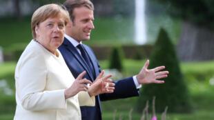 德國總理默克爾與法國總統馬克龍資料圖片