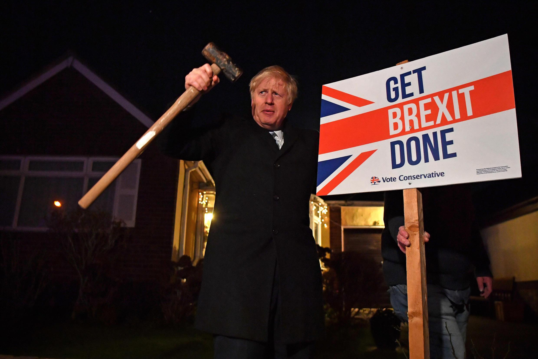British Prime Minister Boris Johnson holding a pro-Brexit sign on 11 December 2019
