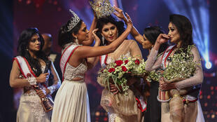 """Caroline Jurie (2-L) was arrested on charges of assault over an on-stage fracas in which she pulled the crown off the head of the new """"Mrs Sri Lanka"""""""