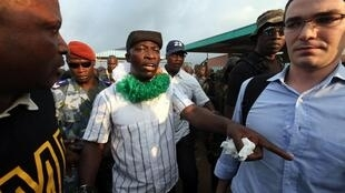 Goude, leader of Côte d'Ivoire's incumbent leader Gbagbo's Young Patriots group, walks after a meeting in Yopougon