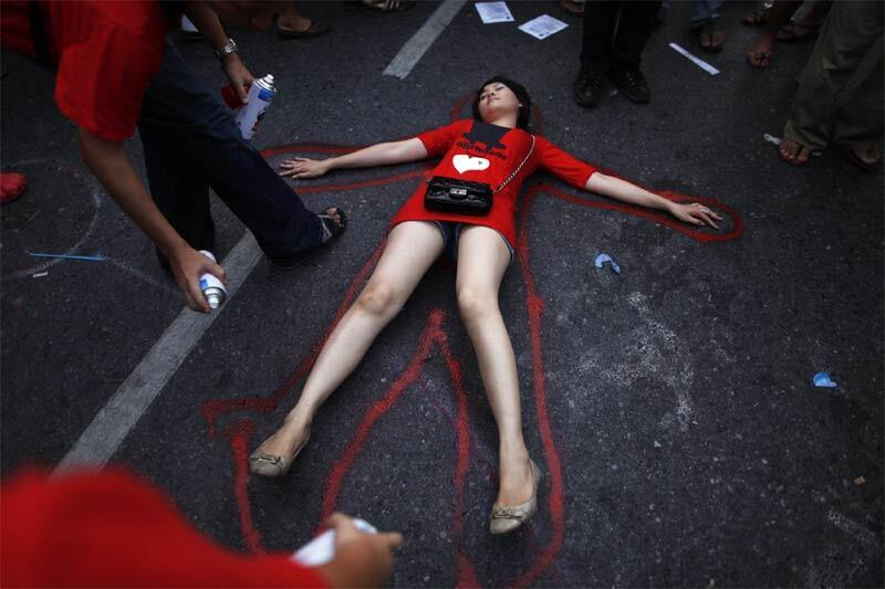 Red Shirts spray a red line around a girl representing one of those killed last year