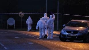 Police officers at the scene of the car bomb attack in County Tyrone, Omagh