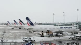 Air France planes on the snow-covered tarmac at Paris's Charles de Gaulle airport in December