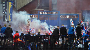 More than 20 arrests were made as Rangers fans clashed with police after celebrating their first Scottish Premiership title in 10 years