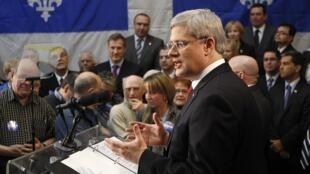 Le Premier ministre canadien Stephen Harper, lors d'une allocution publique, le 26 mars 2011.