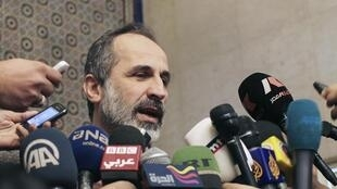 Экс-лидер сирийской Национальной коалиции после встречи с ЛАГ в Каире 11/02/2013 (архив)