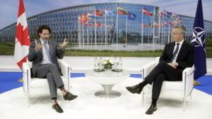 加拿大总理特鲁多与北约秘书长斯托尔滕贝格资料图片