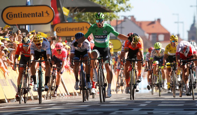Peter Sagan of Slovakia wins stage 5 of the Tour de France, ahead of Team Jumbo-Visma rider Wout Van Aert and Mitchelton-Scott rider Matteo Trentin, 10 July 2019.