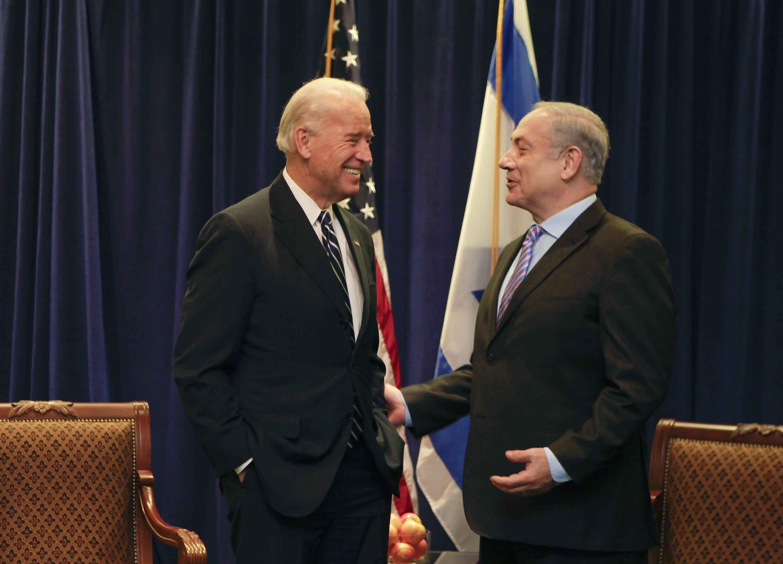 جو بایدن رئیس جمهوری آمریکا و بنیامین نتانیاهو نخست وزیر اسرائیل. .