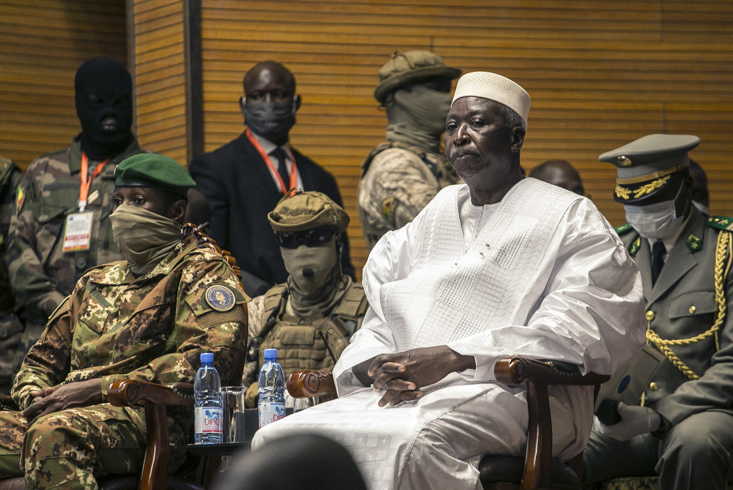 Former Defense Minister and retired Col. Maj. Bah N'Daw, (right), and Col. Assimi Goita, (left),