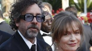 Cannes jury president Tim Burton with actress Isabelle Huppert
